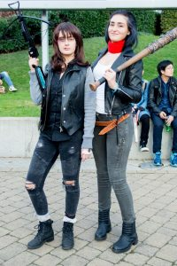 A couple in a long-distance relationship with costumes from the zombie series The Walking Dead