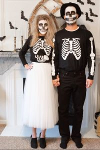 Couple in long-distance relationship with skeleton costumes for Halloween