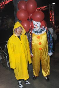 Couple in long-distance relationship with costumes from the horror film It for Halloween